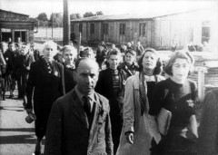 Theresienstadt, Czechoslovakia, 1944, Inmates on their way to work, from a propaganda film- 15526686180218320650.jpg