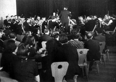 Theresienstadt, Czechoslovakia, 1944, A concert in the concert hall in the ghetto from a propaganda film. 8997763038122278063.jpg