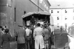 Theresienstadt, Czechoslovakia, unloading supplies from Red Cross trucks, 30-05-1945.9901646329936868887.jpg